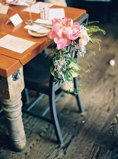 Floral chair decor - photo by Julie Cate Photography http://ruffledblog.com/intimate-brunch-wedding-in-denver