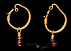 Roman 'Garnet Pendant' Earrings   Gold and garnet, 3.01 grams, 34.94 mm/2.90 grams, 33.71 mm. 1st century BC-4th century AD.  A pair of loop-and-pendant earrings formed from expanding gold wire formed into a hoop with twisted hook and loop ends. Each pendant is formed from wire with a securing collar and two pierced garnets.  Reference: Higgins, R.A. Greek and Roman Jewellery, London, 1961 plate 54 A, C. Very fine condition, complete. Provenance: from an old English collection.