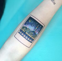Polaroid tattoo by Tattooist IDA