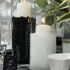 Black and White Candles sitting in Water Pearls Pearl Centerpiece, Wedding Centerpieces, Wedding Table, Wedding Decorations, Centerpiece Ideas, Wedding Favors, Wedding Ideas, Wedding Supplies, Wedding Stuff