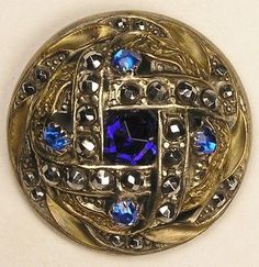 "large, unique ""Gay 90's"" button set with cobalt blue glass faceted stone, blue pastes and cut steels. ca. 1890 - 1910"