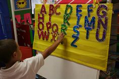 hide letters around the classroom. students find them & put them in order.