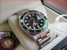 Dubizzle.com | Men's Watches: ROLEX 50 ANNIVERSARY GREEN SUBMARINER COLLECTORS WATCH BOX & PAPERS