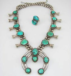 Navajo Sterling Silver Kingman Turquoise Naja Squash Blossom Necklace Ring G | eBay $785.00 Buy it Now. This is nice. It comes with a matching ring as a sort of bonus (never turn down turquoise).