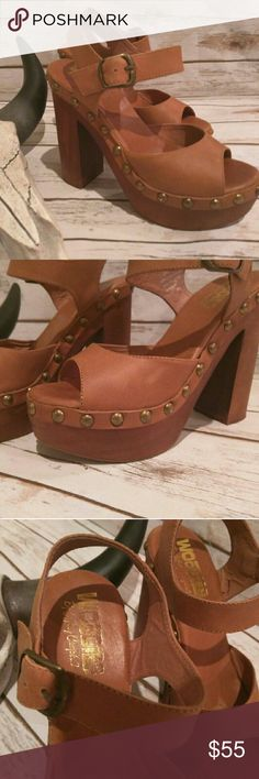 Woodies by Jeffrey Campbell Iconic wooden platform 70s style studded sandals. Worn a handful of times. No obvious marks or damage. See pics for some minimal marks. Ankle strap, 5' heel, 2' platform. Jeffrey Campbell Shoes Sandals