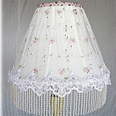 I like the sheer fabric on the shade. Skip the beads and use lace that matches...
