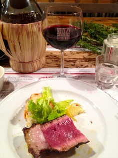 Bistecca Fiorentina , typical roasted beef with red Chianti. try it!