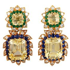 VAN CLEEF & ARPELS Golden Sapphire, Emerald and Diamond Earrings   Van Cleef & Arpels 18kt. Yellow Gold Yellow & Blue Sapphire. Emerald & Diamond Earrings.
