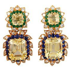 VAN CLEEF & ARPELS Golden Sapphire, Emerald and Diamond Earrings   Van Cleef & Arpels 18kt. Yellow Gold Yellow & Blue Sapphire. Emerald & Diamond Earrings.