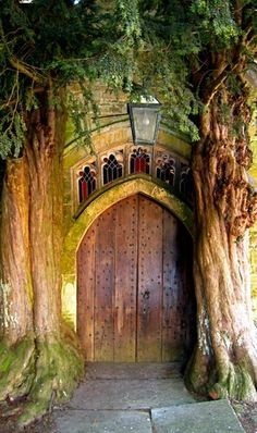 A pair of ancient yew trees guard the north door of St. Edward's Parish…