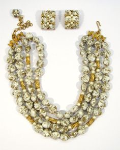 Kramer Art Swirl Bead and Pearl Demi Parure / This gorgeous Kramer demi parure consists of the necklace and earrings. The four strand necklace is decorated with white and taupe swirl lucite beads, filigree bead beads and synthetic peqarls /135