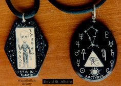 "Two Water Buffalo horn and Elephant Ivory pendants with Alien motifs ""Stargate"" and ""Arcturus"" featuring regular and reverse scrimshaw. By David Pudelwitts-St. Albans 1986"