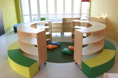 curved shelves with seating inside & along the outside edge