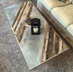 "Industrial Coffee Table -$645 This sleek table is constructed of reclaimed pallet/barn wood, Steel gas pipe and inlaid polished concrete. Will look great in any modern contemporary  living or family room. Dimensions: 26"" Wide 56"" Long 18"" Tall. Size and design and can be customized."