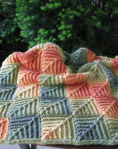 Mitered blanket made with self-striping yarn.