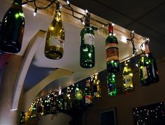 Wine bottle craft lighting, such a good idea to screw the cap onto wood so the bottle can hang!