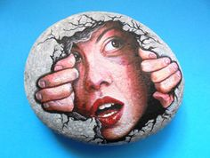 Rock Painting girl looks through a hole on the by KanetisStones