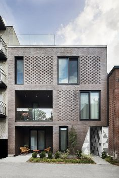 The residential building by Adhoc Architectes is characterised by the contrast between the sober brick facade and the blazing triangular metallic skin of the inner courtyard. Modern Residential Architecture, Brick Architecture, Sustainable Architecture, Pavilion Architecture, Japanese Architecture, Brick Cladding, Brickwork, Brick Detail, Facade Design