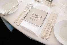 """Each place setting was set with a custom CD. Katie telling """"For our bonbonierre we made CD's for our guests. We asked our bridal party to each choose a song to put on there and state a reason why they had chosen it."""""""