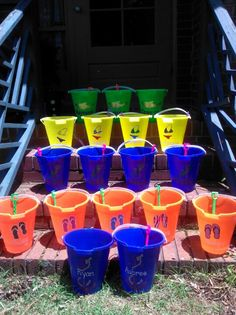 sand buckets to hold supplies for each group table