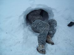 Sgt. Tailor L. Myrick, C Co, 307th Expeditionary Signal Battalion, construct a snow cave improvised shelter in preparation for bivouac operations as part of Arctic Light Individual Training (ALIT). ALIT training is an annual requirement for all Soldiers assigned to United States Army Alaska (USARAK). Photo provided by Command Sgt. Maj. Carlos M. Medina.
