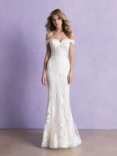 Off-the-shoulder lace fit and flare gown with illusion back, available off-the-rack at Silk Bridal Studio.