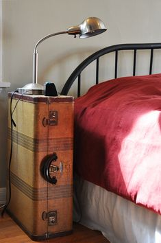 John's bed side table is actually a vintage suitcase, which provides just one luxury - a reading lamp.
