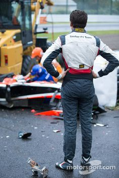 Adrian Sutil, Sauber F1 Team looks on as the safety team at work after the crash of Jules Bianchi, Marussia F1 Team  | Japan 2014