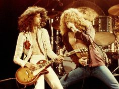 Jimmy Page and Robert Plant perform a Led Zeppelin gig in 1976