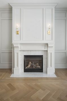 Traditional sitting room + herringbone flooring + white fireplace + wall paneling + art above fireplace + sconces on mantle + traditional fireplace design Fireplace Mantel Designs, House Design, Home Fireplace, Living Room With Fireplace, Marble Fireplaces, House Interior, Herringbone Floor, Fireplace Trim, Fireplace