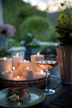 Delicious appetizer, bright candles and champagne are the three main elements of a successful romantic dinner