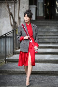 90+ Outfits That Are All About The Shape #refinery29  http://www.refinery29.com/2015/03/83106/milan-street-style-mfw-2015#slide-28  Embellish your crossbody straps for extra oomph over an outfit.Chanel bag.