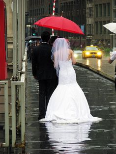 Getting caught in the rain..on your wedding day..damn