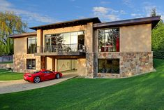 This West Bellevue House in Washington, USA with just two bedrooms is centered around a massive 16-car garage.
