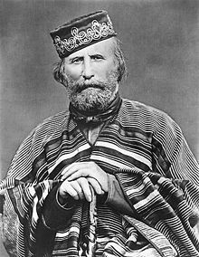 """Giuseppe Garibaldi (Italian: [dʒuˈzɛppe ɡariˈbaldi]; 4 July 1807 in Nice – 2 June 1882 on Caprera) was an Italian general and politician who played a large role in the history of Italy. He is considered, with Camillo Cavour, Victor Emmanuel II and Giuseppe Mazzini, as one of Italy's """"fathers of the fatherland""""."""