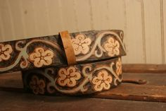 Leather Belt Carved - Brown, white, sage, gold - Ginger Pattern with cherry blossom flowers. $198.00, via Etsy.