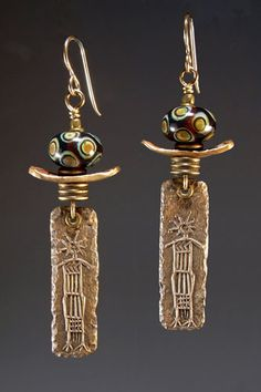 I like the use of California Indian petroglyph designs on the bottom panel. from http://mountainrobbins.com/earring.html