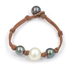 Wendy Mignot Fine Pearls and Leather Jewelry the authentic world renowned brand defining Gypset Style and Bohemium Chic presents the Three Pearl South Sea White, Tahitian Bracelet from the Fusion Collection. Discover Wendy Mignot Designs in the eBoutique.