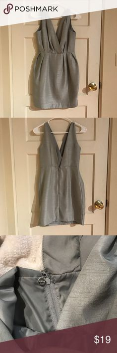 Silver gray H&M dress with deep V Re-poshing bc it's slightly too big for me. In good condition! H&M Dresses Mini