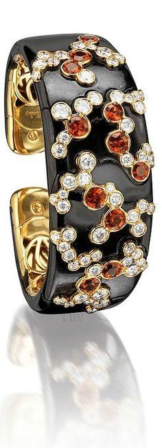 Bonhams ♥✤An orange sapphire and diamond 'Fujiyama' bangle*, signed by Marina B