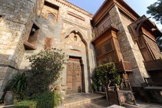 """ca1985, Sami Angawi: his own house in Jeddah, a city on the Red Sea, Saudi Arabia. The stone facade at the entrance to his house is from Mecca and about 350 years old. He salvaged it from a home that was being demolished during the 1980s. """"This was one of the last remaining historical pieces from Mecca,"""" he says."""