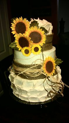 Sunflower - Buttercream covered chocolate and vanilla cakes filled with ganache, strawberry, lemon, and mascarpone! Yummy! Sunflowers are 50/50 blend and dusted with petal and luster dusts.