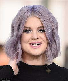 Lovely in lavender: She wore her purple locks down in a  middle part