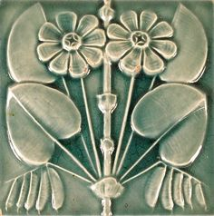 Flower tile from Glaze of Glory exhibit . . . nice design to carve onto pots . . .