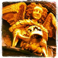 Angel - detail from frontage of Angel & Royal, Grantham
