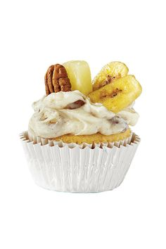 Florida: The Hummingbird - College Football Cupcakes - Southernliving. Inspiration: Tropical fruits  Stir 1 cup chopped toasted pecans and 1/2 tsp. ground cinnamon into frosting. Garnish with fresh pineapple wedges, banana chips, and pecan halves.