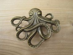 Octopus Drawer knobs Cabinet Knobs Furniture Knobs in Brass Metal is part of cabinet Furniture Knobs - Awesome brass octopus cabinet knobs!The Octopus is all the rage for craft enthusiasts! Dresser Knobs, Cabinet Knobs, Kraken, Metal Animal, Octopus Bathroom, Pirate Bathroom, Steampunk Furniture, Steampunk Interior, Steampunk Octopus