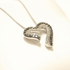 Black and white diamond open heart necklace... Perfect for Valentine's Day! In store and online! #SmokinJoesJewelry #blackdiamond #heart #valentinesgift