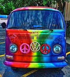 """The Volkswagon bus was commonly driven by """"hippies"""". These hippie buses were easily spotted with their vividly painted colors and peace sign symbols. Volkswagen Bus, Vw T1, Vw Vanagon, Taste The Rainbow, Over The Rainbow, Combi Ww, Mundo Hippie, Van Vw, Vw Beach"""