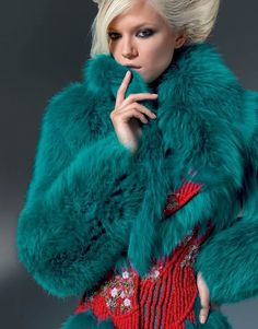 Evening fox turquoise coat embroidered at the waist in a corals and cherry blossoms pattern for a corset effect ((Versace))